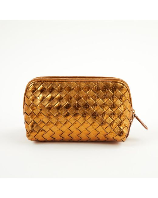 a87304ab09 ... Bottega Veneta - Metallic Pre-owned Gold Leather Clutch Bags - Lyst