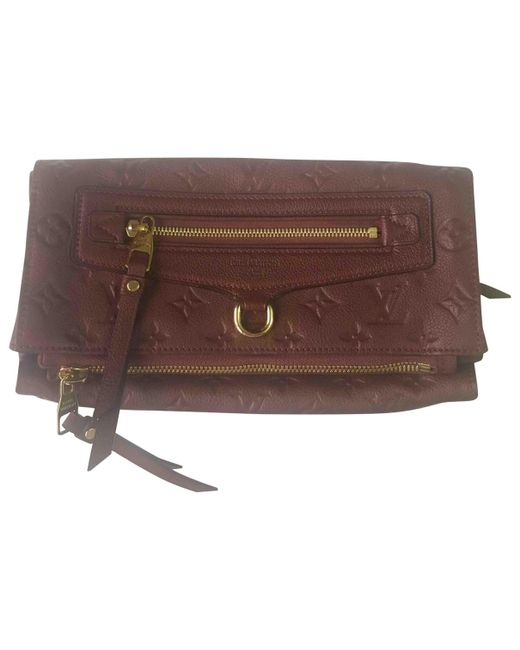 Louis Vuitton - Brown Pre-owned Burgundy Leather Clutch Bags - Lyst