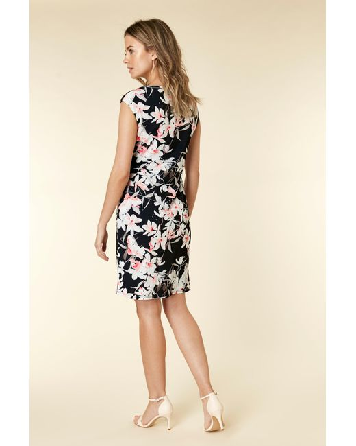 9445881a7e34bc ... Wallis - Petite Black Floral Print Shift Dress - Lyst ...