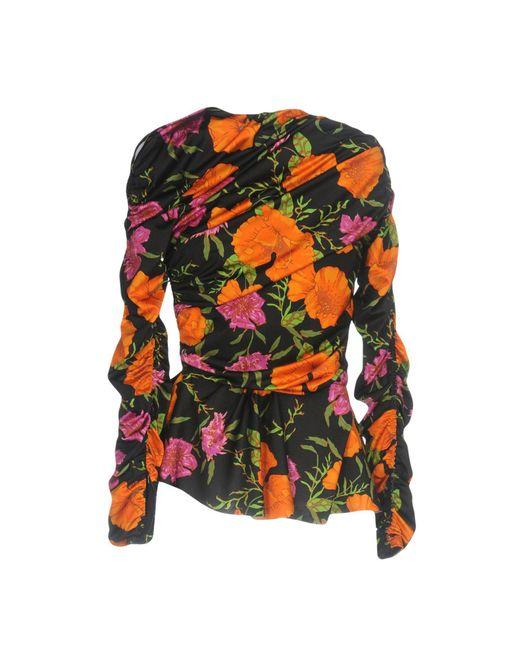 3d294dd89298 Lyst - Balenciaga Floral-print Ruched Peplum-hem Top in Black - Save 64%