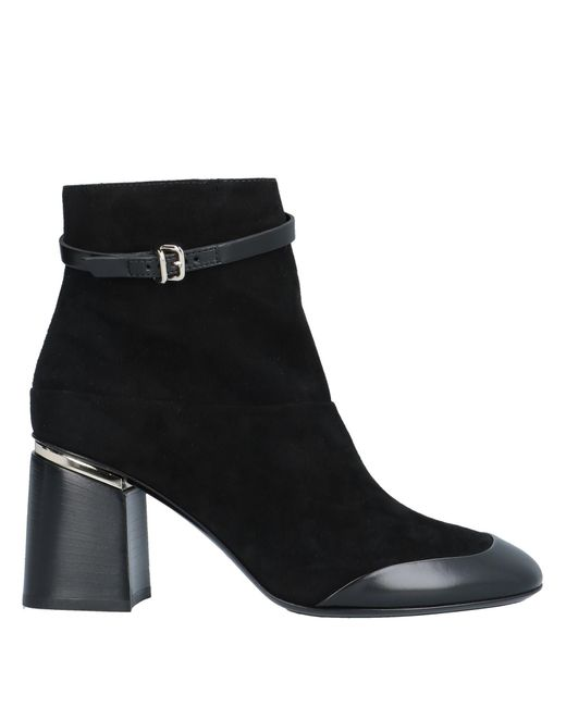 Tod's Black Leather And Suede Ankle Boots