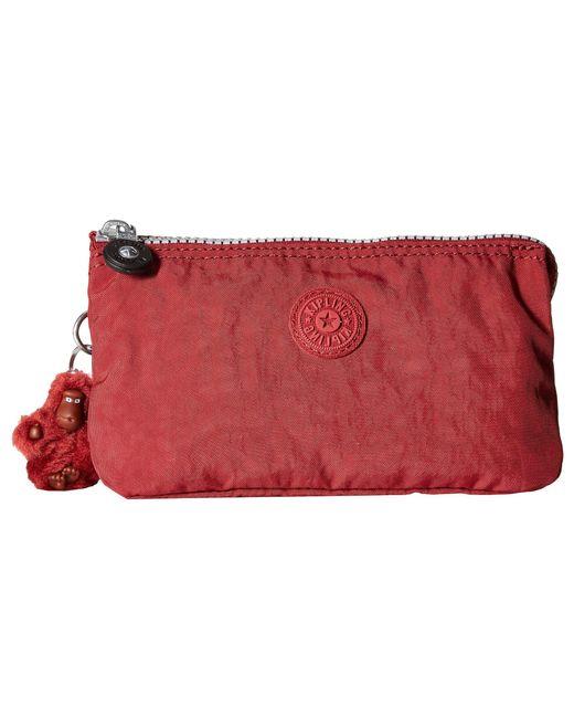 Kipling - Red Creativity Large Pouch (black) Clutch Handbags - Lyst