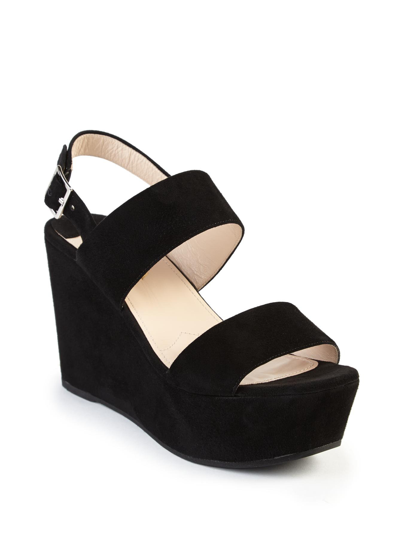 Once you start, you won't be able to stop talking about how cute the CL by Laundry Go On Black Suede Platform Ankle Strap Heels are! Soft, vegan suede covers these brag-worthy platform heels with a wide peep-toe strap, heel cup with cutout detail, and adjustable ankle strap (with gold buckle). 1