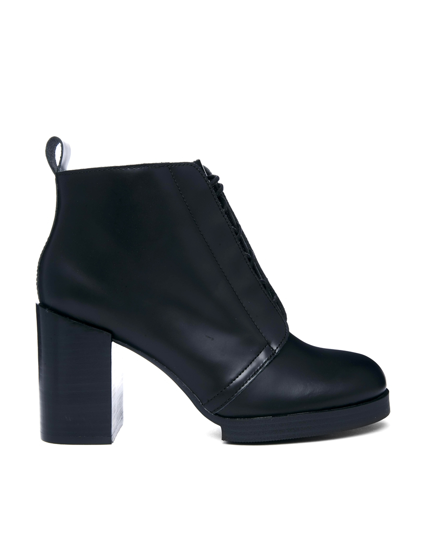 cheap monday layer heeled ankle boot in black lyst