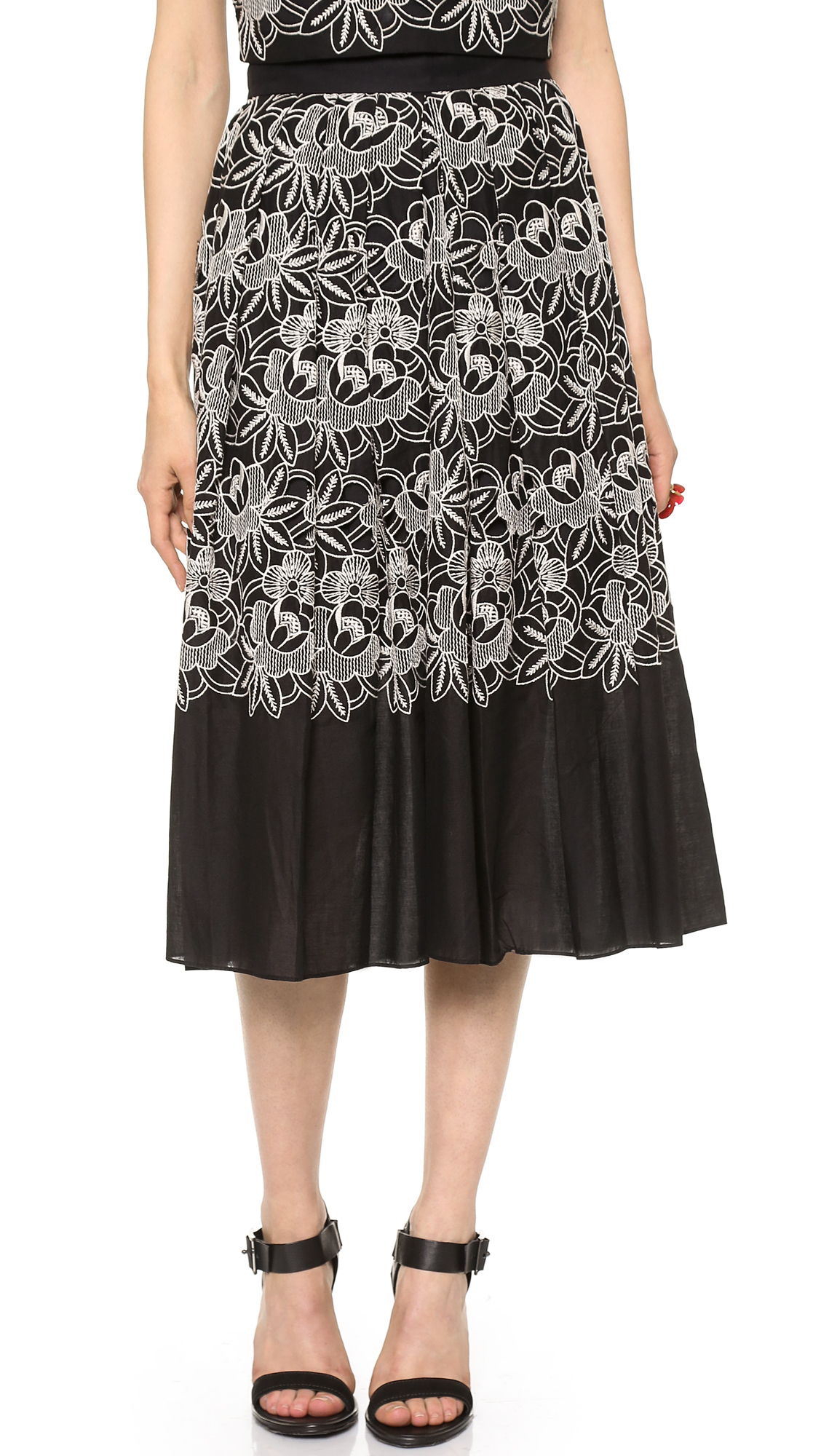 Black Eyelet Skirt: Travel. This loft eyelet ruffle wrap skirt was my gateway black eyelet skirt. The ruffle and wrap detail were what sold me. Both were just so feminine that it got me to reconsider a black skirt for summer.