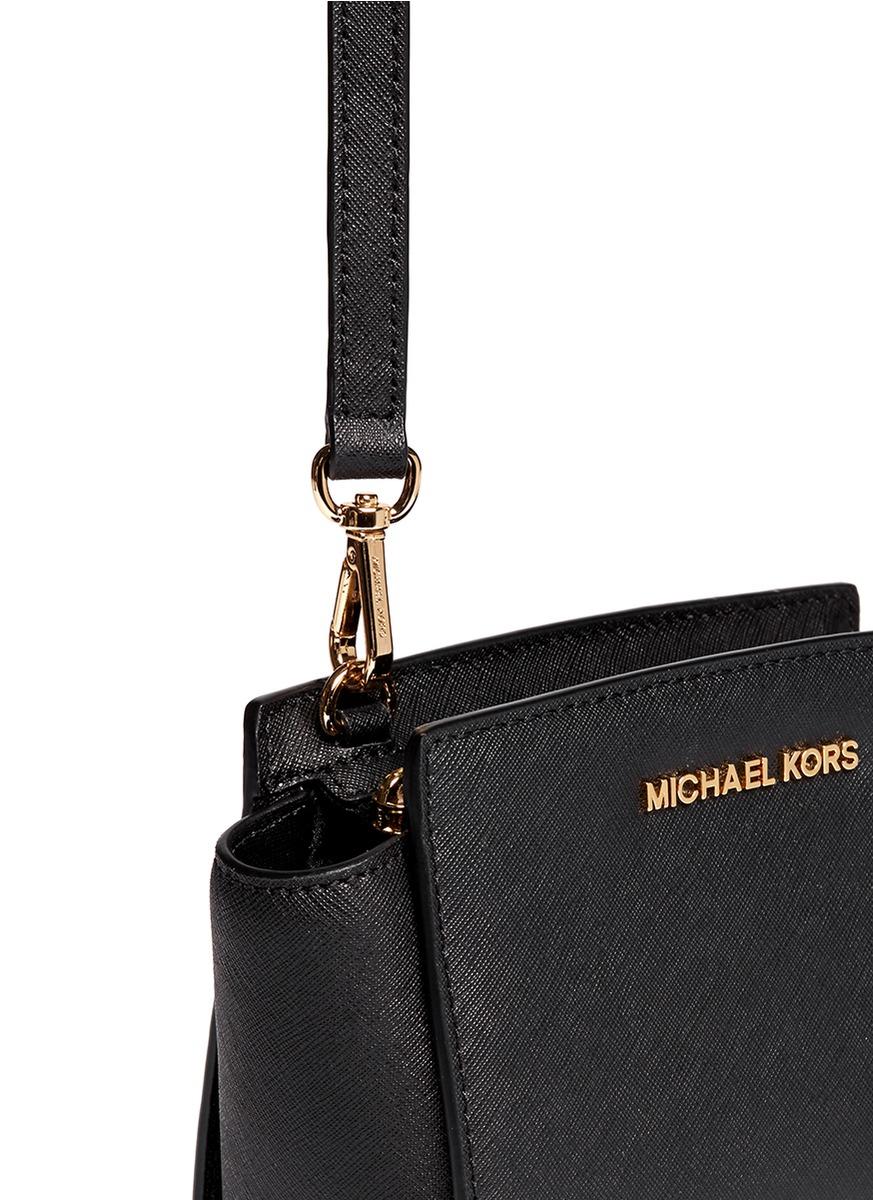 4233d4521eb03 ... order lyst michael kors selma mini saffiano leather messenger bag in  black 51aad 9dd3a