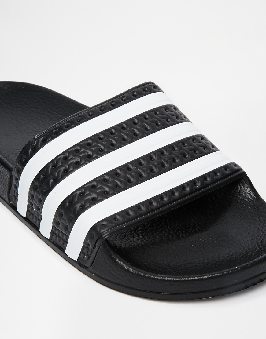 5d753e04409bb Lyst - adidas Originals Originals Adilette Black   White Stripe ...