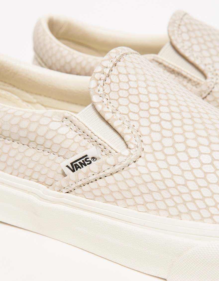 3a989443ab Lyst - Vans Classic Snake-Embossed Leather Slip-On Sneakers in Natural
