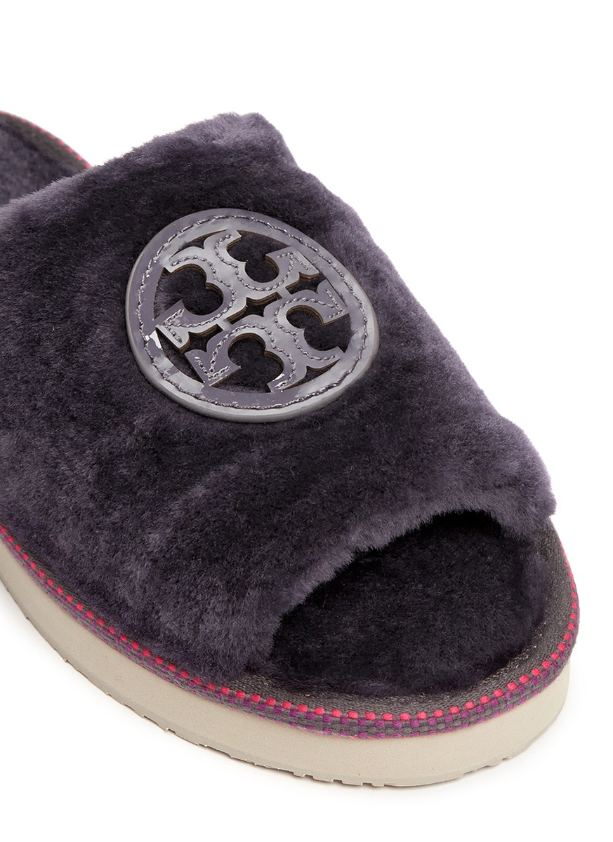 tory burch logo patch shearling slippers in purple lyst