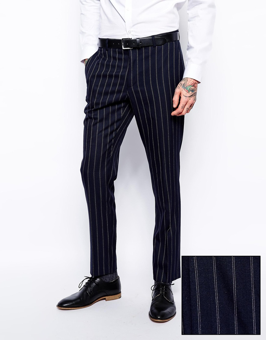 To get more out of your existing wardrobe, wear striped pants with a suit jacket in a contrasting solid color or complement striped pants with a classic navy sport coat. At Men's Wearhouse, you'll find striped pants offered in percent wool, wool and cotton blends and in traditional and slim-fit styles. Today, the most popular looks are flat-front, but we'll help you find pants with pleats if you prefer.