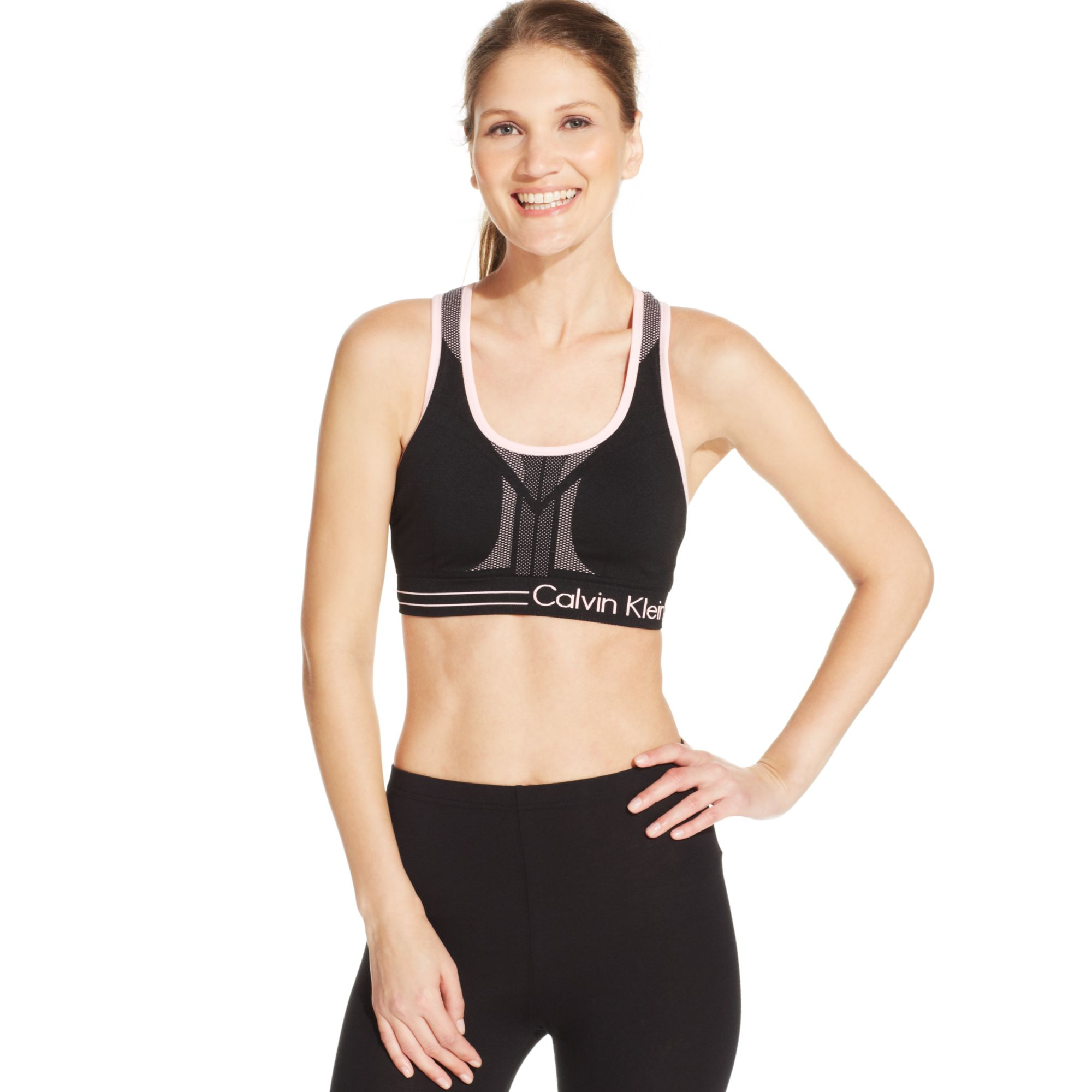 55328e61342c5 Lyst - Calvin Klein Performance Reversible Racerback Sports Bra in Black