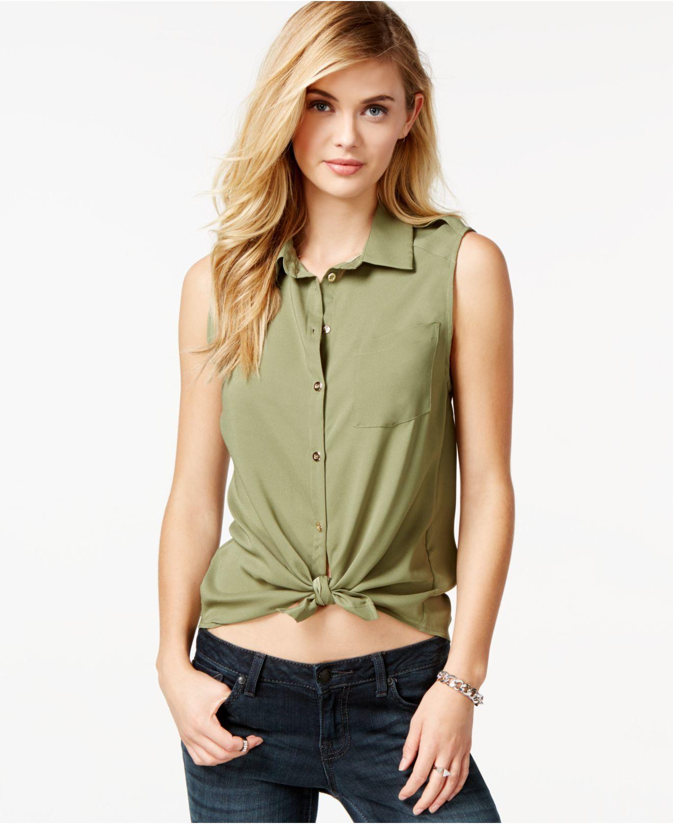 Lyst guess lola sleeveless button down shirt in green for Sleeveless cotton button down shirts