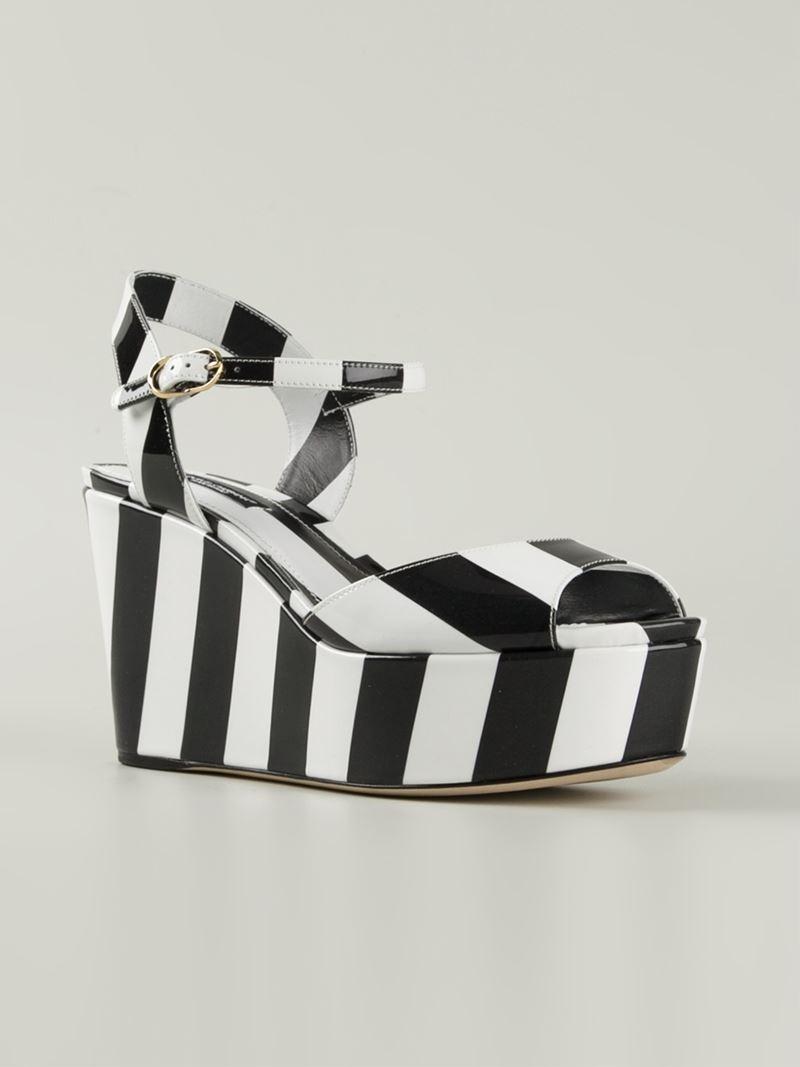 30846ebe62910 Lyst - Dolce   Gabbana Striped Print Wedge Sandals in Black
