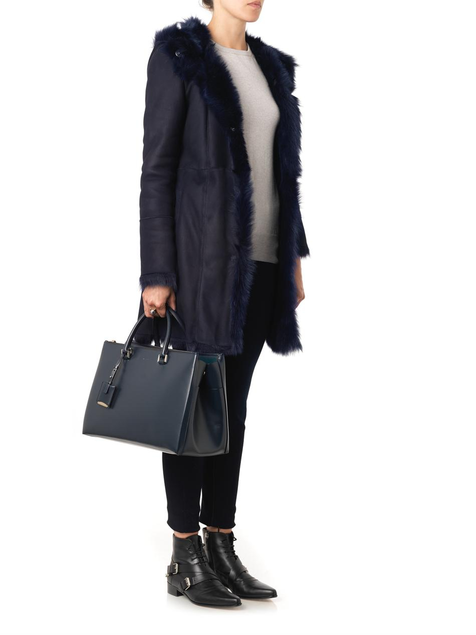 Drome Hooded Navy Shearling Coat in Blue | Lyst