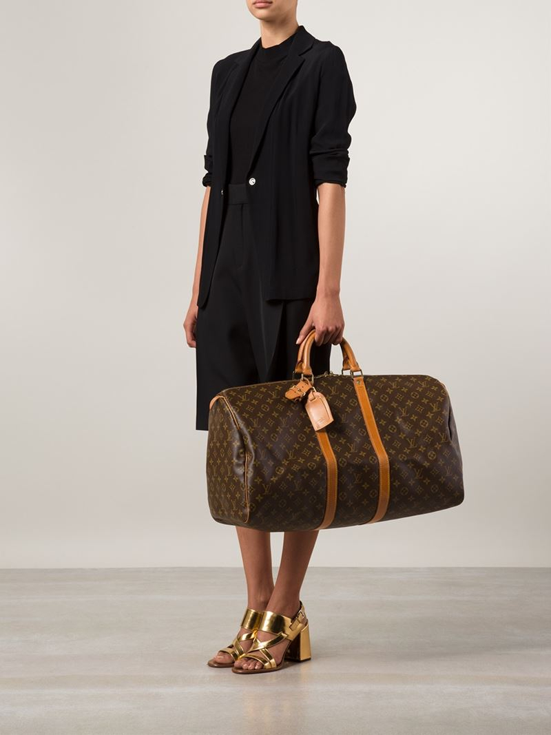 louis vuitton 39 keepall 55 39 travel bag in brown lyst. Black Bedroom Furniture Sets. Home Design Ideas