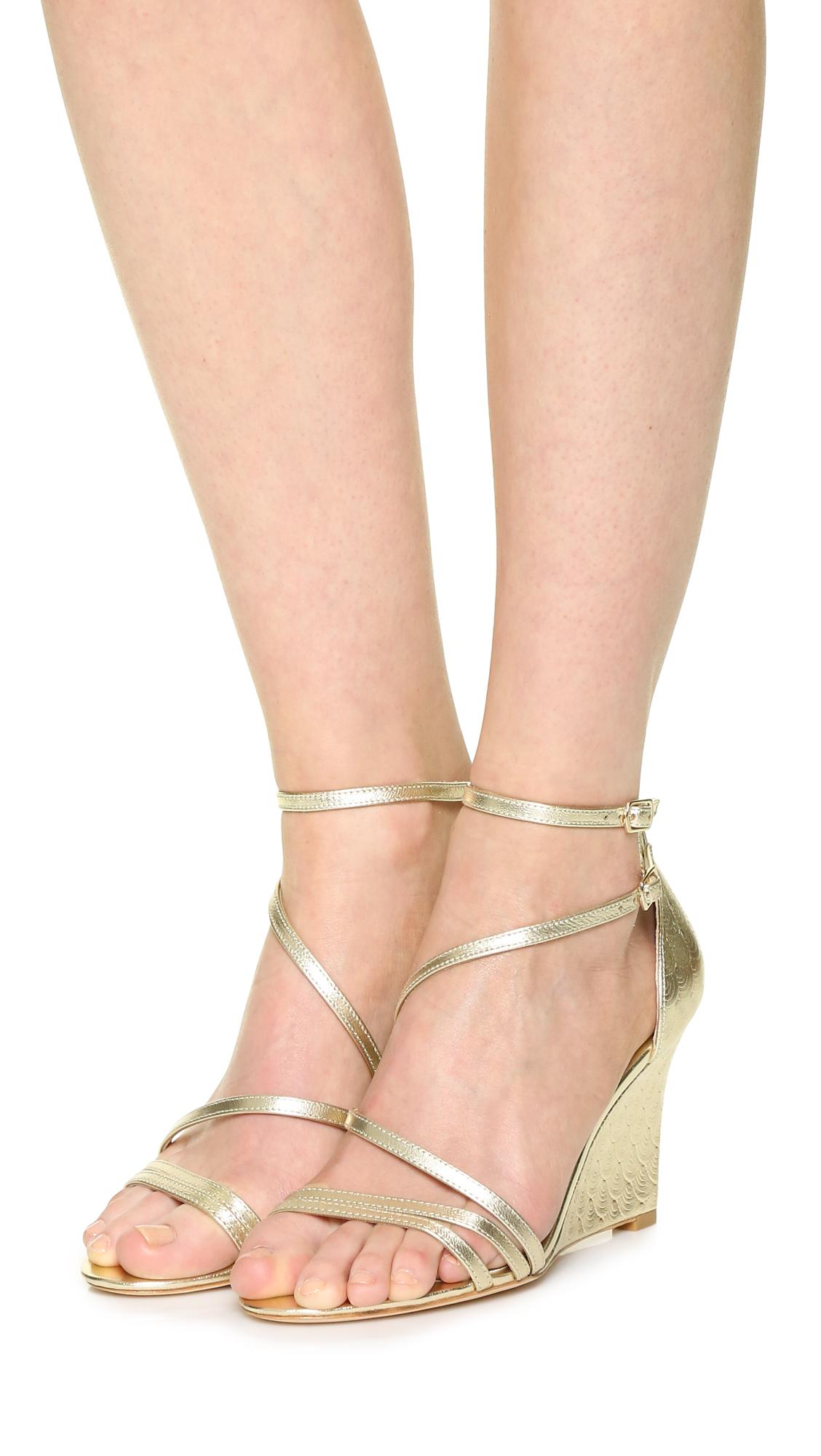 14927bb07 Lyst - Badgley Mischka Carnation Ii Wedge Sandals in Metallic