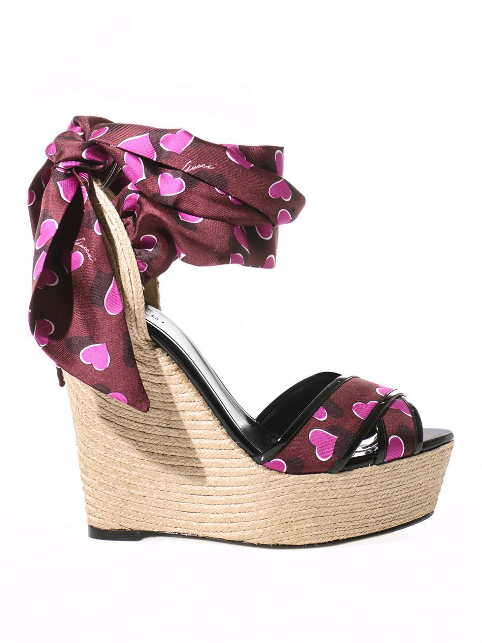 f92ce3e80487 Lyst - Gucci Carolina Raffia Silk Wedge Sandals