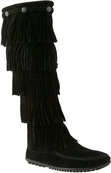 minnetonka 5 layer fringe boot in black lyst