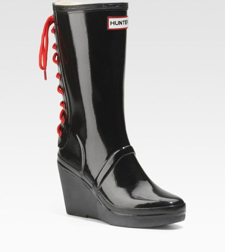 glossy rubber wedge boots in black lyst