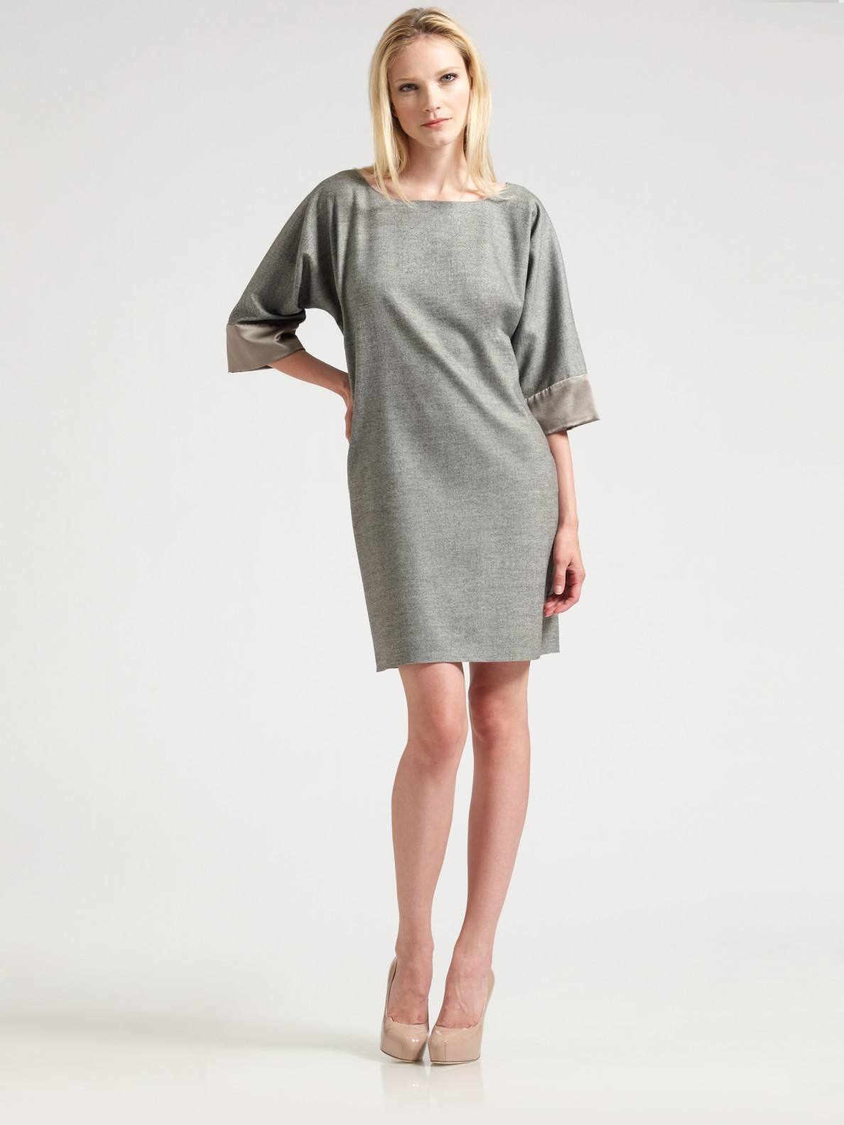 Like a three quarter sleeve top, this type of dress offers you that in-between temperature where a long sleeve might be too hot and a short sleeve, too cold. It is kind of like capris for your arms. The shorter sleeve length offers a nice option when layering with a blazer or sweater, yet is long enough to avoid being accused of emulating.