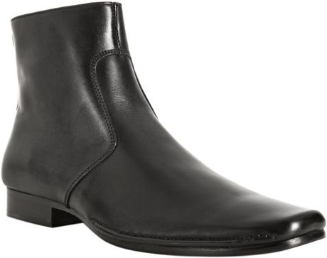 kenneth cole black leather run ankle boots in black