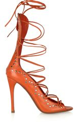 Alaïa Studded Leather Laceup Sandals in Orange - Lyst