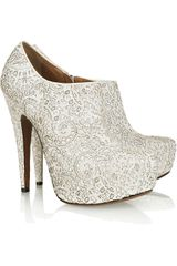 Alaïa Laser-cut Calf Hair Platform Pumps