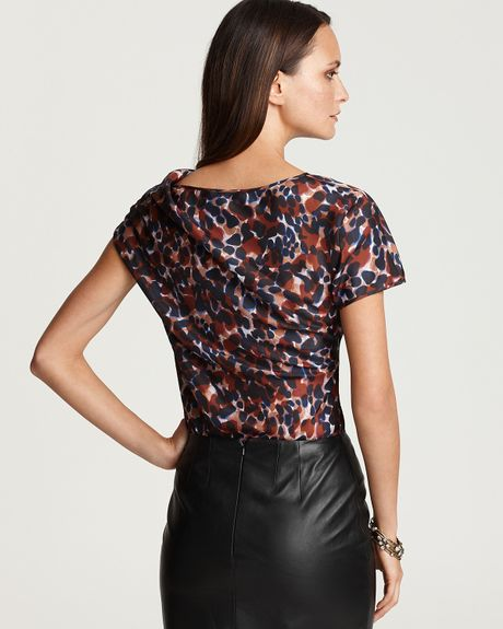 black leopard print silk blouse and leather pencil