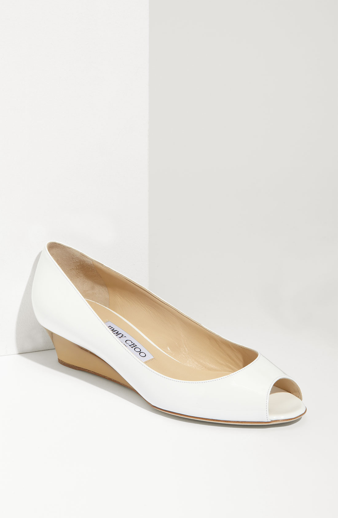 Browse David's Bridal collection of affordable wedding wedges in a variety of designs & colors including white, silver, gold, tan & more that you'll love!