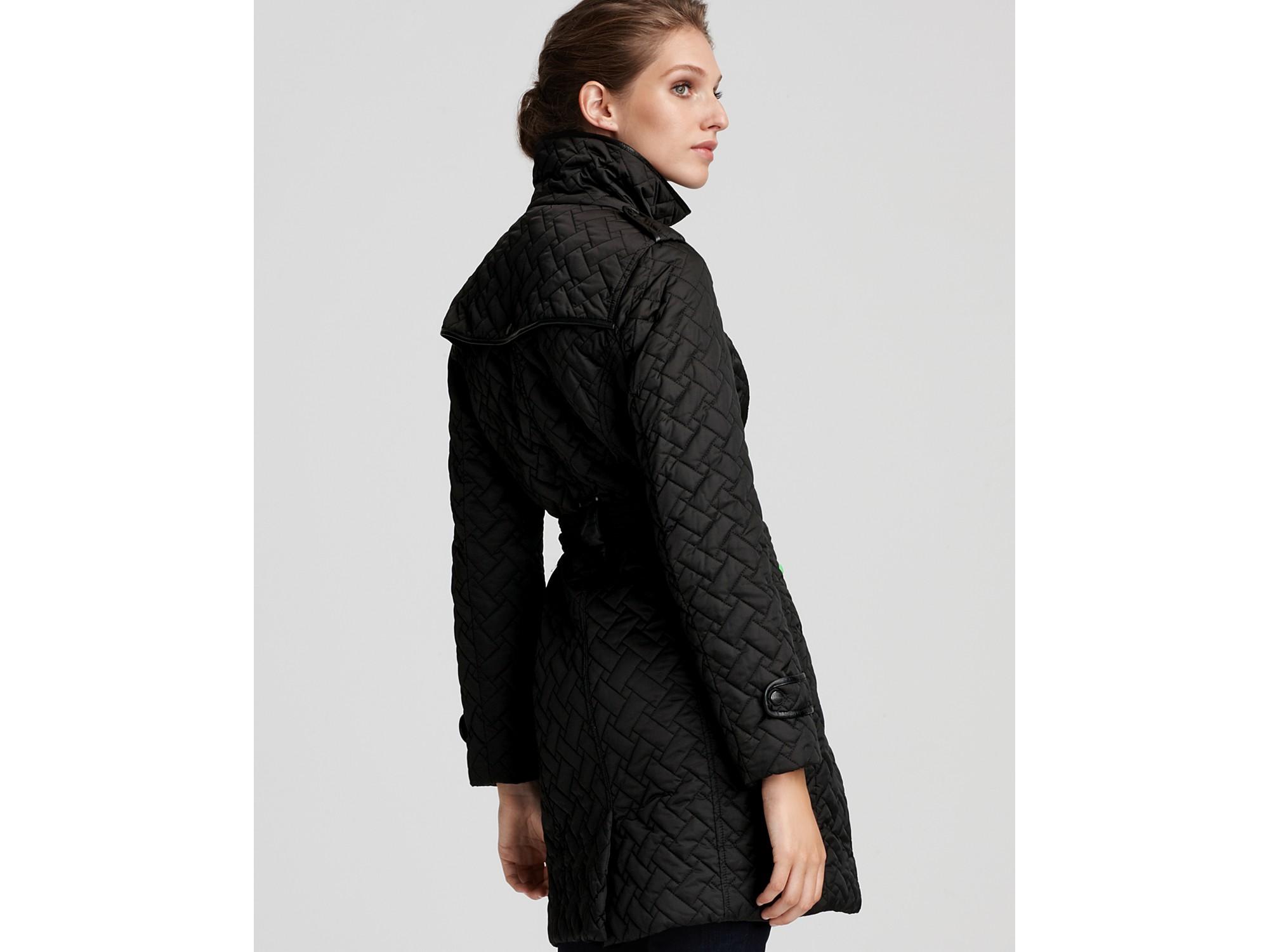 Black quilted belted jacket