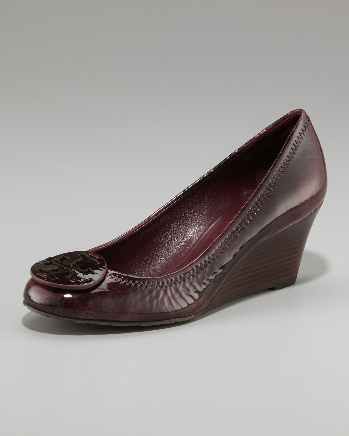 56189324d97 Lyst - Tory Burch Sally Logo Patent Wedge Pump in Brown