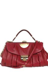 Nina Ricci Pleated Calfskin Top Handle in Purple (burgundy) - Lyst
