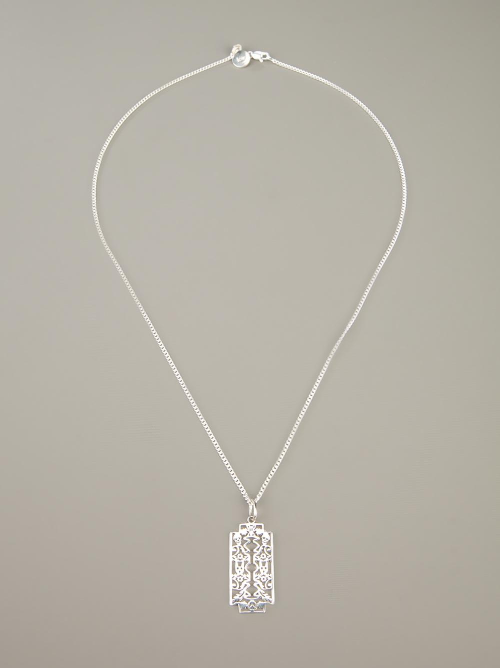 95537c831d7 Lyst - Karen Walker Razor Pendant in Metallic