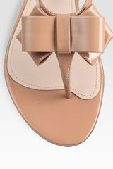 Miu Miu Patent Leather Tstrap Bow Sandals in Beige (nude) - Lyst