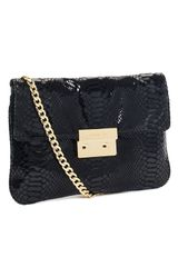 Michael by Michael Kors Sloan Python-embossed Clutch, Black - Lyst