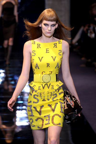 Versace Fall 2012 Sleeveless Boatneck Corseted Mini Dress  With Mirrored Letter Print In Yellow  in Yellow - Lyst