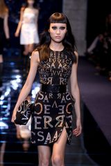 Versace Fall 2012 Sleeveless Mini Dress With Mirrored Letter Print, Asymmetrical Bottom With 3D Detail And Front Slit In Black  - Lyst