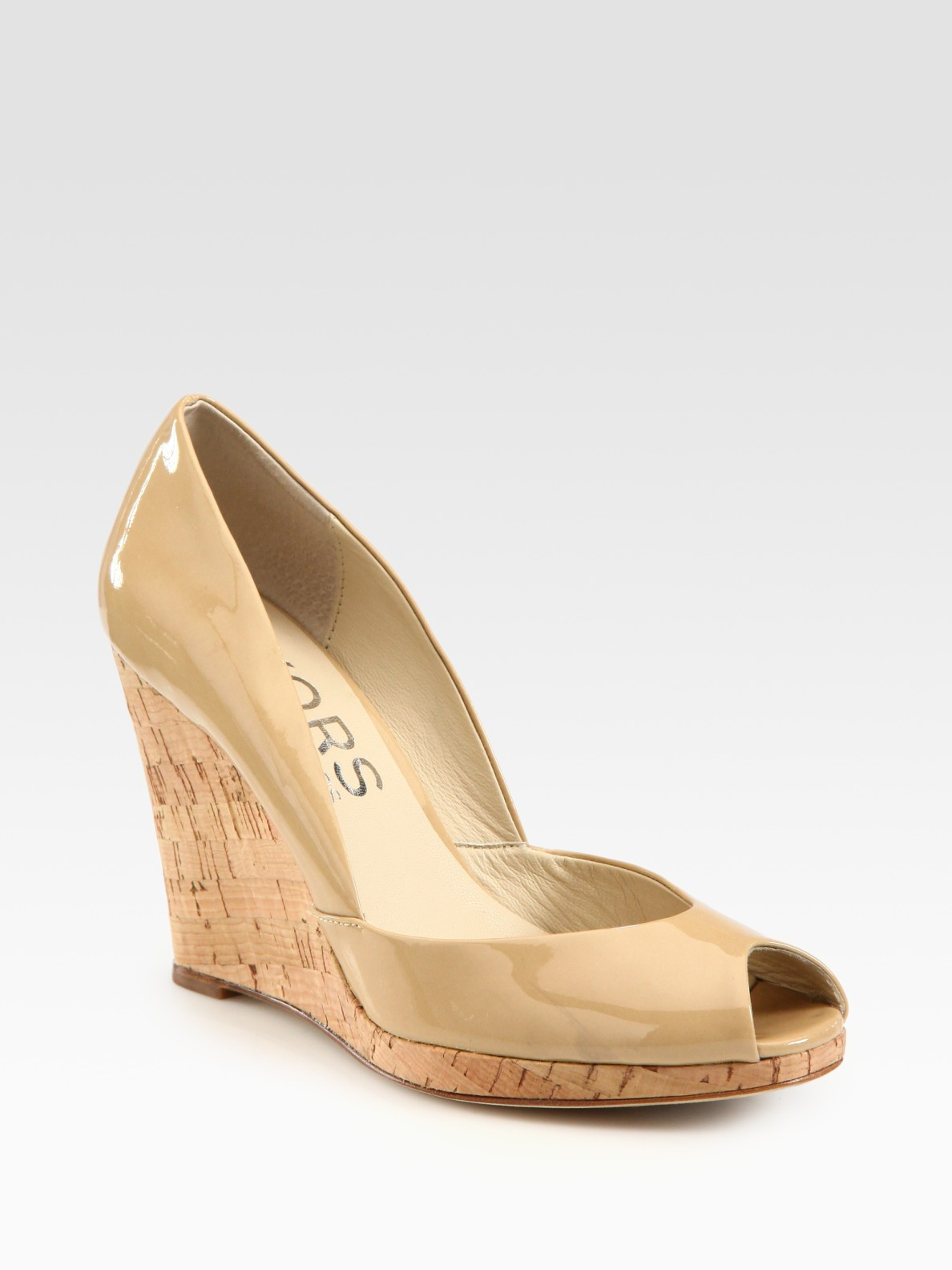 e1d7d036970 Lyst - Kors by Michael Kors Vail Patent Leather Wedge Pumps in Natural