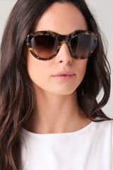Tory Burch Rounded T Logo Sunglasses in Animal - Lyst