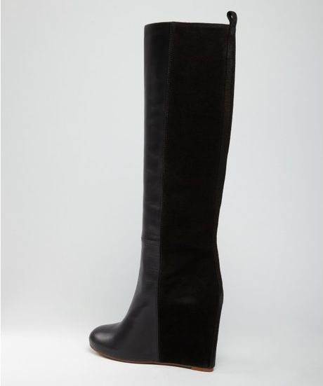 black leather covered wedge boots in black lyst