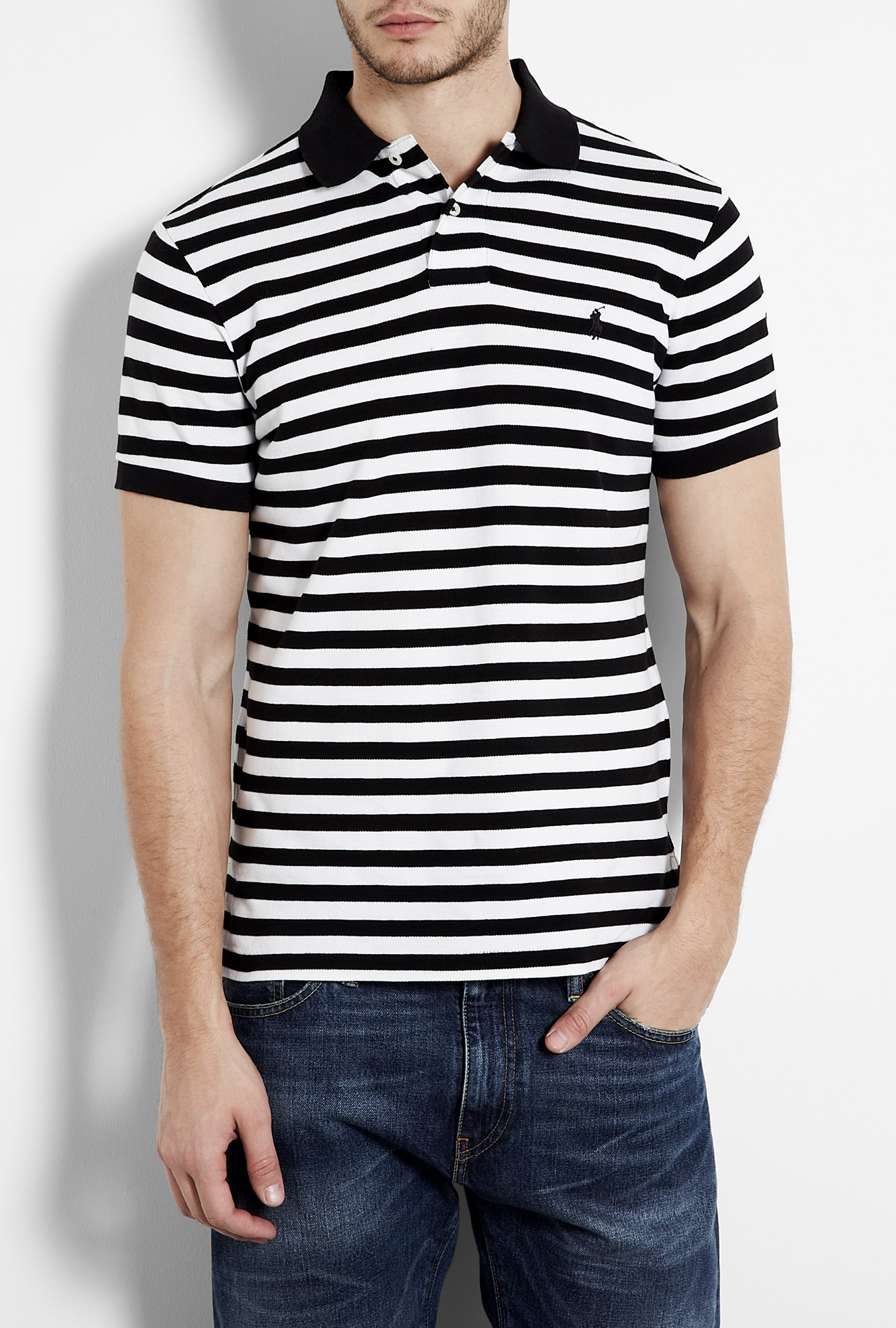 Cool and casual, this Black polo T-shirt with white stripes from Fanideaz will elevate your summer style to new heights, owing to its loose silhouette and nautical stripes. It has a two button placket, contrast colour stripes and full sleeves with elasticated cuffs that .