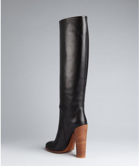 black leather stacked heel boots in black lyst