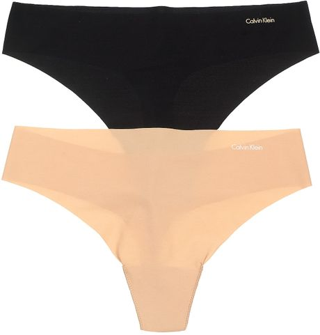Calvin Klein Underwear Thong Invisibles in Beige (light caramel white) - Lyst