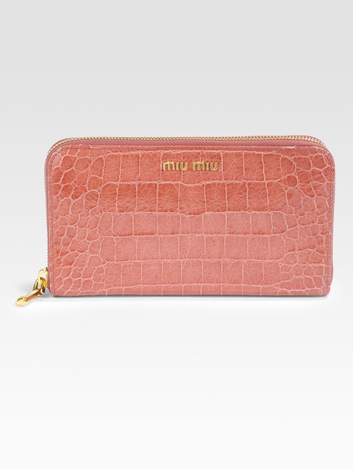 86270465d38b Lyst - Miu Miu Crocodile Embossed Leather Ziparound Wallet in Orange