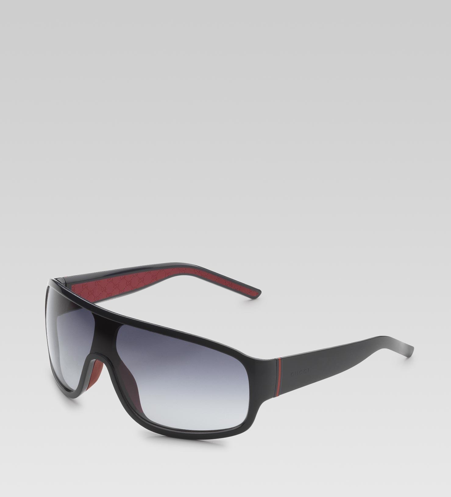 fc2a6ce6139 Gucci Medium Rectangle Mask Sunglasses with Gucci Logo and Web ...