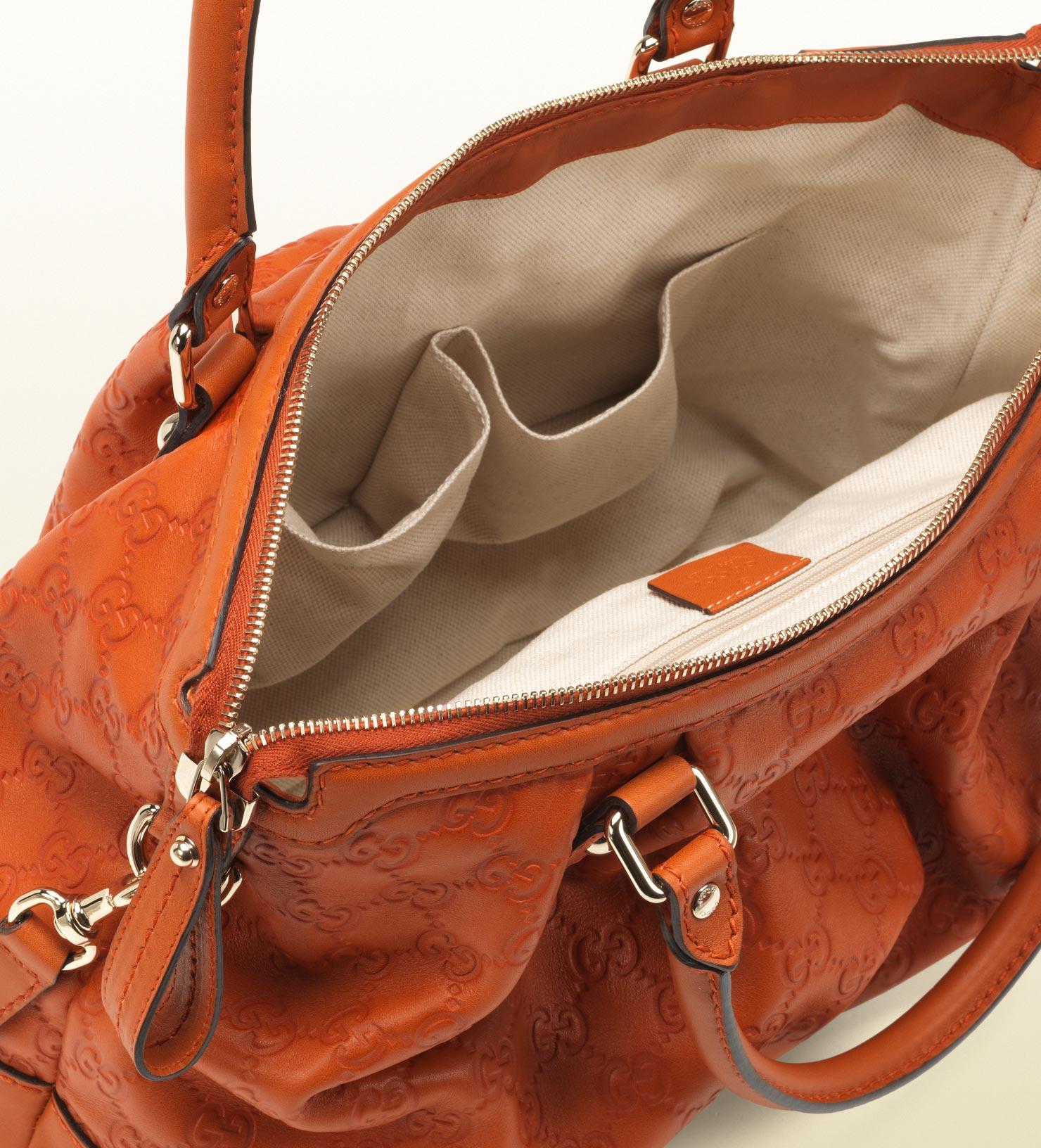 c031d2f2d4ca Gucci Sukey Guccissima Leather Top Handle Bag in Orange - Lyst
