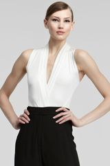 Donna Karan New York Surplice Bodysuit - Lyst