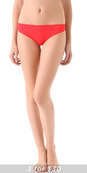 Calvin Klein Invisibles Thong in Red (tomato) - Lyst