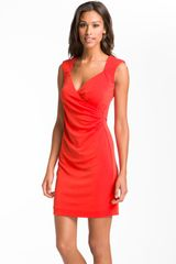 Nicole Miller Surplice Ruched Jersey Sheath Dress in Red (coral) - Lyst