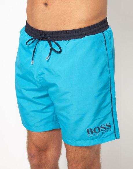 Boss black star fish swim shorts in blue for men lyst for Fishing swim trunks